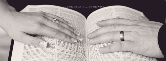 wife and husbands hand on Bible 2017