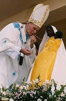 The pope praying to a Black Madonna and Child 2017